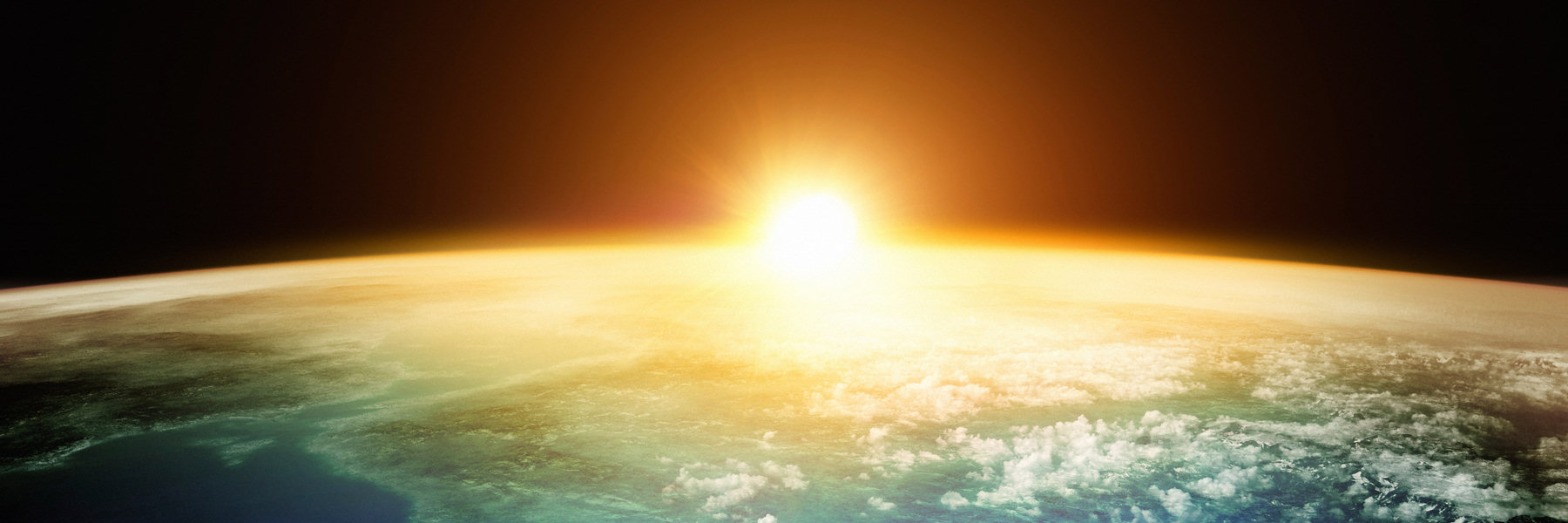 Banner Image - Yellow sun peeking out from earth